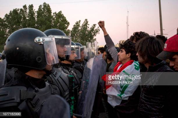 Iraqi security forces confront protestors as they demonstrate against the government and the lack of basic services, on January 4, 2019 in the...