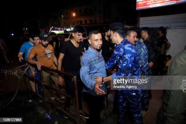 Iraqi security forces control people during the holy month of Muharram commemorations in Baghdad Iraq on September 19 2018 Ashure or Noah's Pudding...