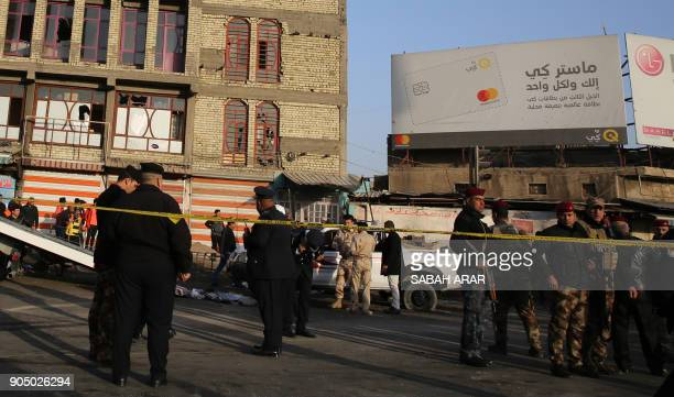 Iraqi security forces cordon off the area where a double suicide bombing killed more than 20 people in central Baghdad on January 15 the second such...