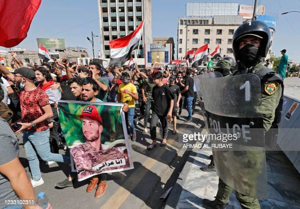 Iraqi security forces deploy during a demonstration in Tahrir Square in Baghdad on May 25 to demand accountability for a recent wave of killings...