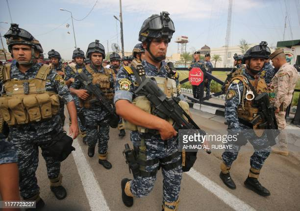 Iraqi security forces guard a symbolic funeral procession attended by high-ranking officials in Baghdad on October 23, 2019 for Major General Ali...