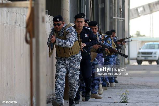 Iraqi security forces in charge of the port security take part in an exercise to simulate a terrorist attack on February 8 2016 at the Iraqi port of...