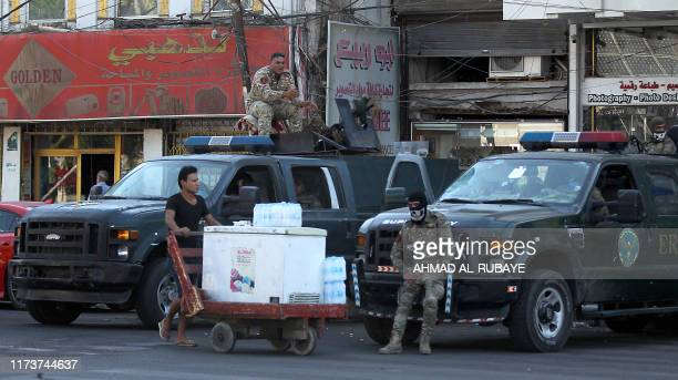 Iraqi security forces keep watch at Tahrir Square in central Baghdad on October 5 2019 after a curfew was lifted following a day of violent protests...