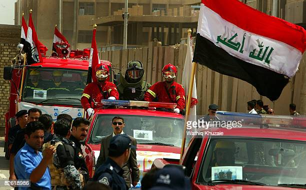 Iraqi security forces parade during a handover ceremony at the government headquarters September 1 2008 in Ramadi the capital of Anbar province 180...