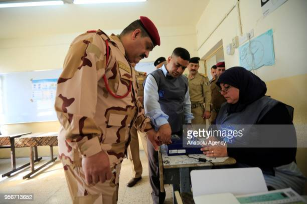 Iraqi security forces register their name to vote during the special voting day for the Iraqi parliamentary election at a polling station in Baghdad...