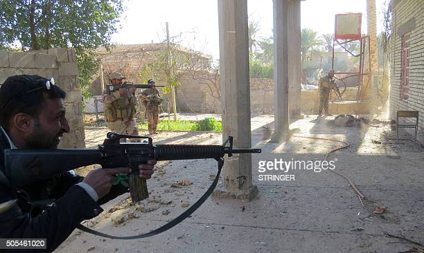 Iraqi security forces search a building as they clear alSajarya district on the eastern outskirts of Ramadi the capital of Anbar province on January...