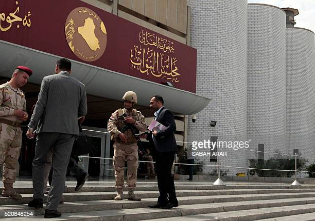 Iraqi security forces stand guard outside the parliament in Baghdad on April 13 during a sitin by lawmakers to protest against the system of...