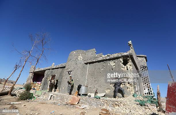 Iraqi security forces take combat position in the rural town of Husayba in the Euphrates Valley seven kilometres east of Ramadi on December 7 where...