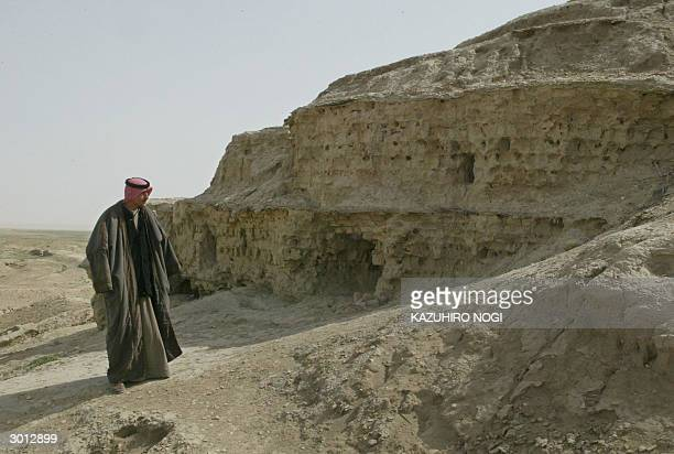 Iraqi security guard and guide Ahmad Moher reaches the top of the Ziggurat which rises to a height of 16 meters on a square base measuring 60x60...