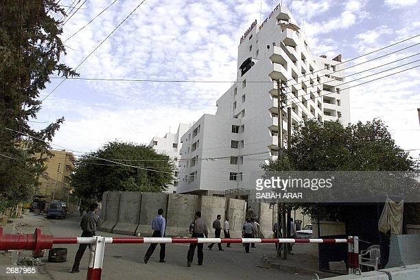 Iraqi security men stand guard in front of the alHamra hotel used by foreign journalists in Baghdad 01 November 2003 Numerous Baghdad residents...