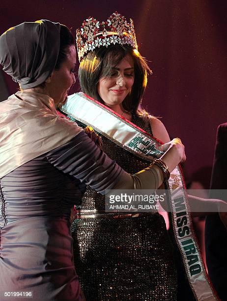 Iraqi Shaymaa Qasim Abdelrahman from Kirkuk receives the Miss Iraq sash after winning the beauty contest on December 19 2015 in the capital Baghdad...
