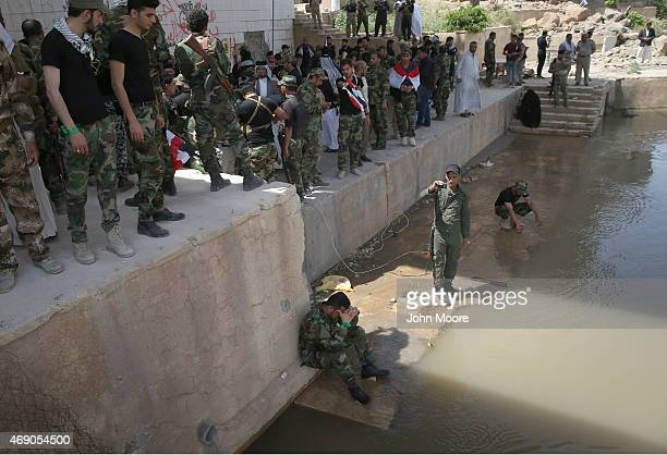 Iraqi Shia Badr Brigade militia and allied students mourn along the Tigris River in the palace compound of former Iraqi President Saddam Hussein on...