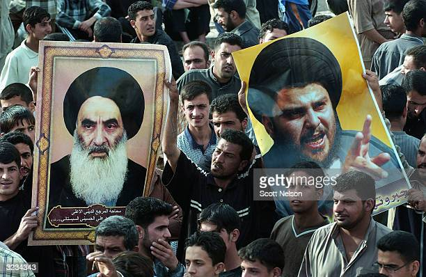 Iraqi Shia demonstratrors hold up portraits of Iraqi Shia cleric Moqtada al-Sadr and Grand Ayatollah Ali al-Sistani during a demonstration and show...