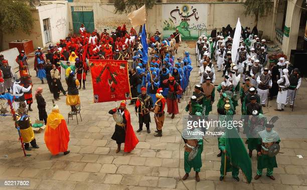 Iraqi Shiite actors reenact the battle of Kerbala in which Imam Hussein grandson of Prophet Muhammad was killed as they celebrate the Religious...