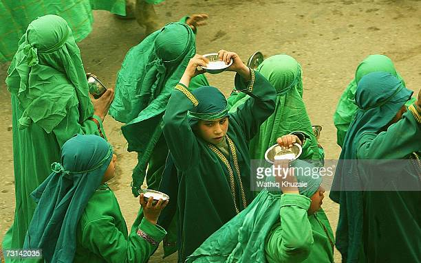 Iraqi Shi'ite boys reenact the Battle of Karbala as part of the annual tenday mourning period of Ashura on January 29 2007 in Karbala Iraq Thousands...