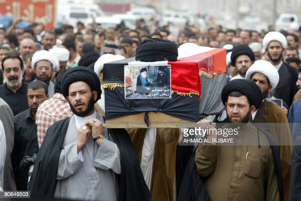 Iraqi Shiite clergyman carry a mock coffin during a symbolic funeral in Baghdad's Shiite enclave of Sadr City for Riyad alNuri the director of the...