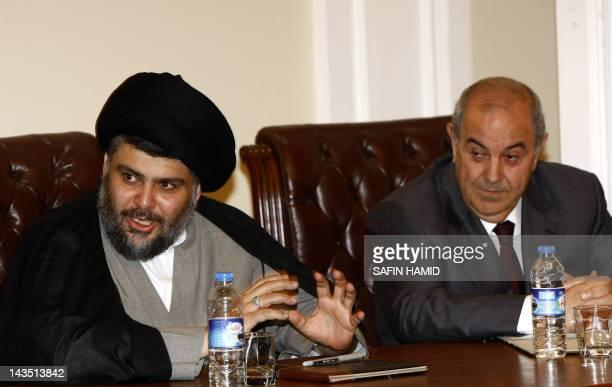 Iraqi Shiite cleric Moqtada al-Sadr and former premier Iyad Allawi attend a meeting of Iraqi leaders in Arbil, the capital of Kurdistan in northern...