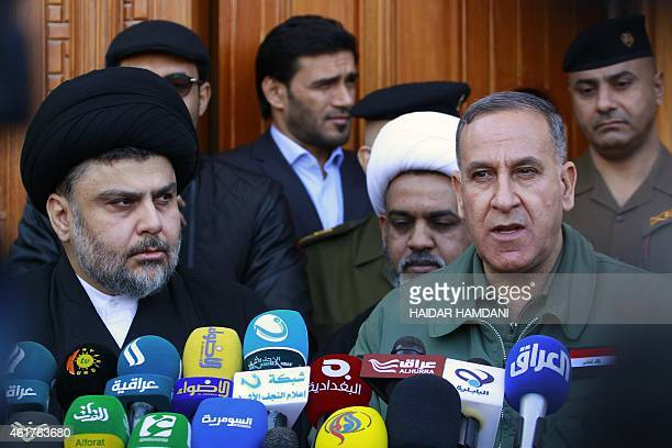 Iraqi Shiite cleric Moqtada al-Sadr and Iraqi Defence Minister Khaled al-Obeidi hold a press conference following a meeting on January 19, 2015 in...