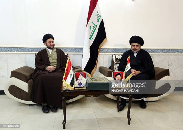 Iraqi Shiite cleric Moqtada alSadr and Iraqi Shiite Muslim leader Ammar alHakim sit during a meeting to discuss economic and security issues held at...