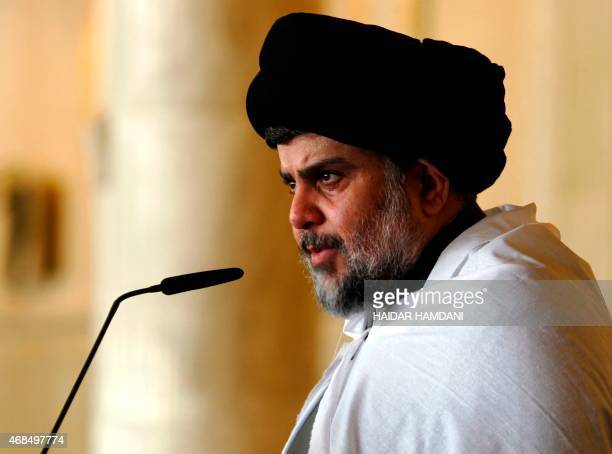Iraqi Shiite cleric Moqtada al-Sadr delivers a speech to his supporters following Friday prayers at the grand mosque of Kufa in the holy city of...