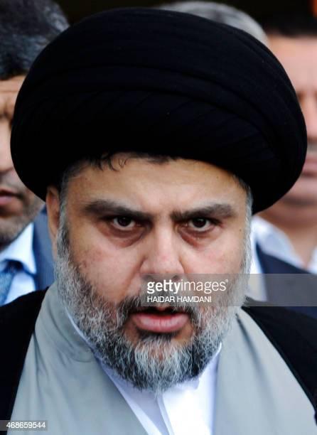 Iraqi Shiite cleric Moqtada al-Sadr looks on after a meeting with Salim al-Jabouri, the Parliament's speaker, alongside other parliament Sunni...
