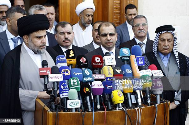 Iraqi Shiite cleric Moqtada al-Sadr speaks to the press after a meeting with Salim al-Jabouri , the Parliament's speaker, alongside other parliament...