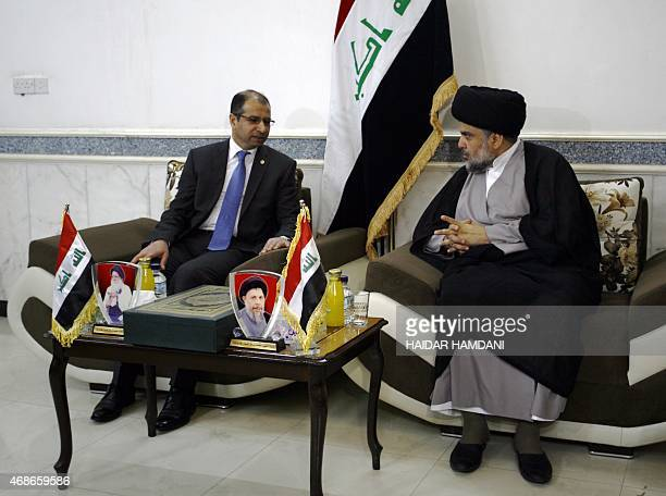 Iraqi Shiite cleric Moqtada alSadr talks to Salim alJabouri the Parliament's speaker during a meeting on April 5 2015 in the holy city of Najaf AFP...
