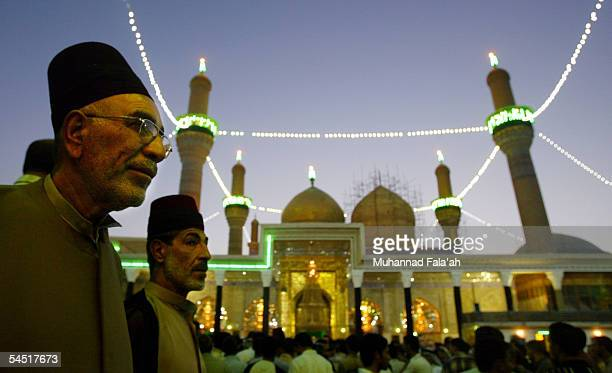 Iraqi Shiite clerics stand in front of Imam Kadhim Shrine as they attend funeral services for the stampede victims September 4 2005 in Baghdad Iraq...