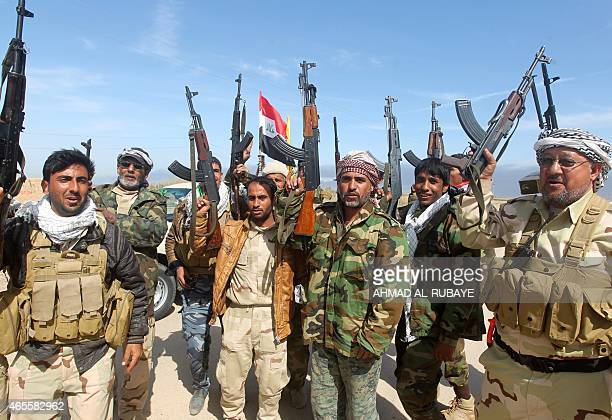 Iraqi Shiite fighters and members of Iraq's Popular Mobilisation units supporting the Iraqi government forces in the battle against the Islamic State...