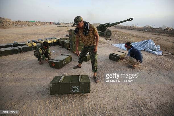 Iraqi Shiite fighters from a Popular Mobilisation unit prepare boxes of ammunition near the city of Fallujah on May 23 as part of a major assault to...