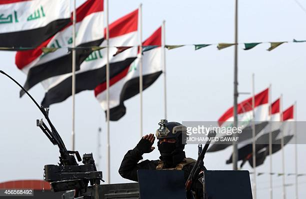 Iraqi Shiite fighters from Tal Afar in northern Iraq, who are loyal to Grand Ayatollah Ali al-Sistani, take part in a parade in the Shiite shrine...