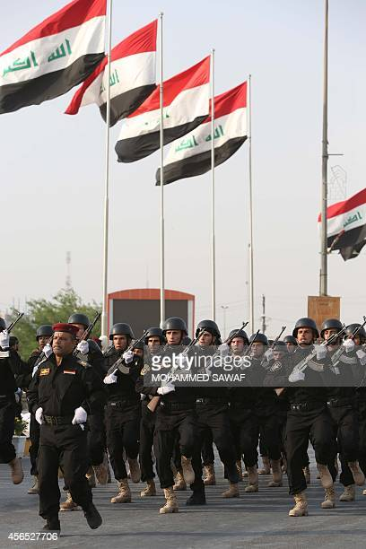 Iraqi Shiite fighters from Tal Afar, loyal to Grand Ayatollah Ali al-Sistani, take part in a parade in the Shiite shrine city of Karbala in central...