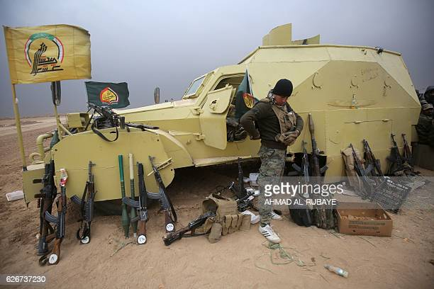 TOPSHOT Iraqi Shiite fighters from the Hashed alShaabi paramilitaries hold a position near the town of Tal Abtah south of Tal Afar on November 30...