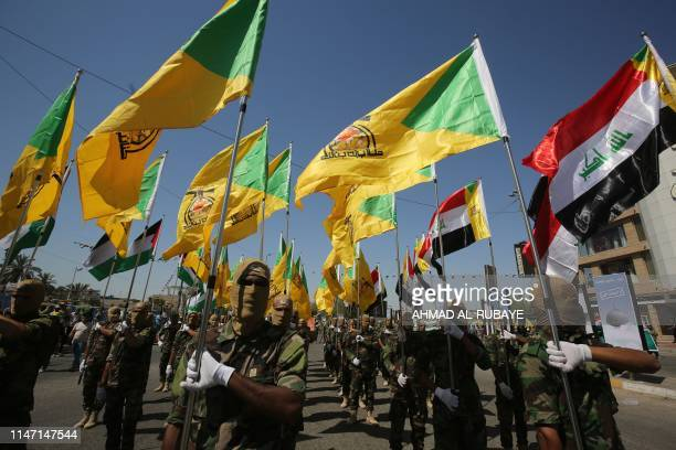 Iraqi Shiite fighters from the Iranbacked armed group Hezbollah brigades march during a military parade marking AlQuds International Day in Baghdad...