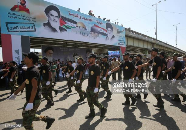 Iraqi Shiite fighters from the Nujaba armed group march during a military parade marking Al-Quds International Day in Baghdad, on May 31, 2019. - An...