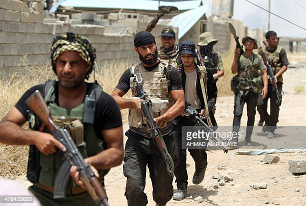 Iraqi Shiite fighters from the Popular Mobilisation units deploy in the city of Baiji, north of Tikrit, as they fight alongside Iraqi forces against...