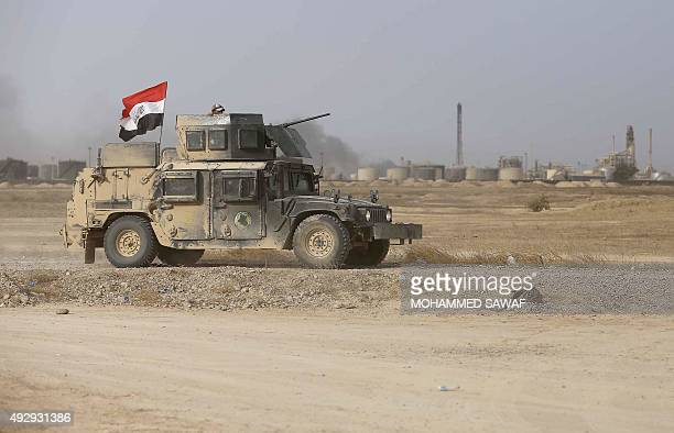 Iraqi Shiite fighters from the Popular Mobilisation units fighting Islamic State jihadists alongside Iraqi government forces drive their armoured...