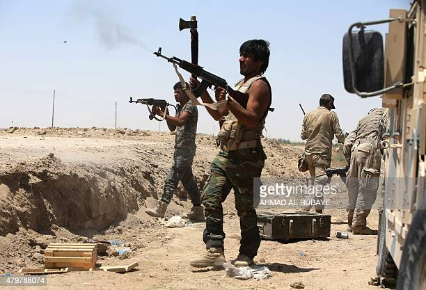 Iraqi Shiite fighters from the Popular Mobilisation units supporting the Iraqi government forces fire towards Islamic State group positions during...