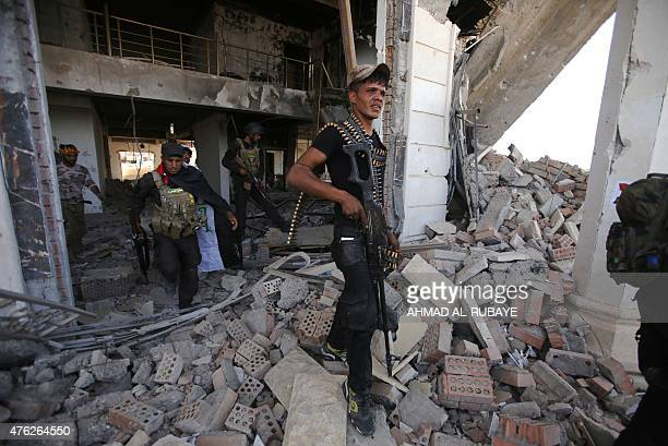 Iraqi Shiite fighters from the Popular Mobilization units inspect a council building in the city of Baiji north of Tikrit in the Salahaddin province...