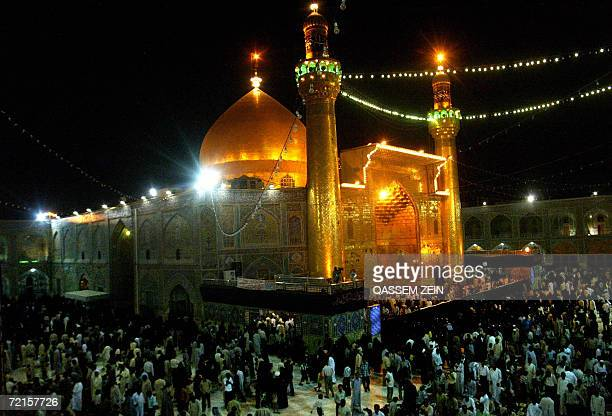 Iraqi Shiite gather outside Shiite Imam Ali's Shrine in the holy city of Najaf central Iraq early 13 October 2006 as they prepare to celebrate the...