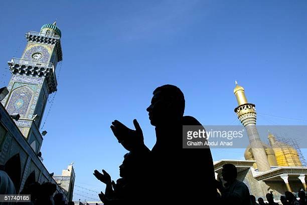 Iraqi Shiite men perform the Eid al-Fitr prayers in the Kadhmiya Shrine November 14, 2004 in Baghdad, Iraq. The Kadimya Shrine is the holiest Shiite...