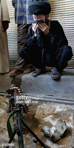 Iraqi Shiite militia commander weeps after receiving an order to evacuate his post and leave Najaf, today August 27, 2004 after rebel leader Moqtada...