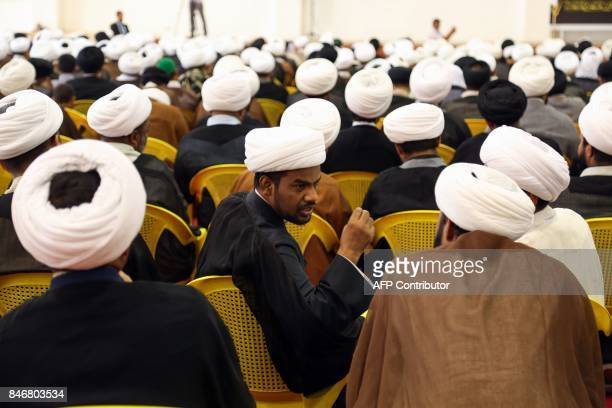 Iraqi Shiite Muslim clerics attend an address given by Ammar alHakim the head of the Islamic Supreme Council of Iraq during a religious conference in...