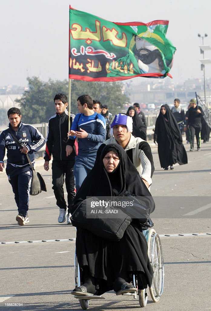 Iraqi Shiite Muslim pilgrims march along the main highway that links the Iraqi capital Baghdad with the central shrine city of Karbala on December 31, 2012, to take part in the Arbaeen religious festival which mraks the 40th day after Ashura commemorating the seventh century killing of Prophet Mohammed's grandson, Imam Hussein. A series of bombings across Iraq killed at least 12 people on the sidelines of upcoming major commemoration ceremonies, including three policemen, and wounded more than 40, officials said.