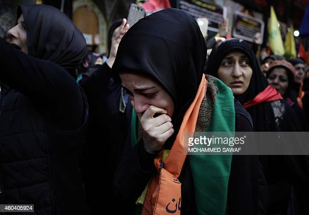 Iraqi Shiite Muslim pilgrims react during the Arbaeen religious festival which marks the 40th day after Ashura commemorating the seventh century...