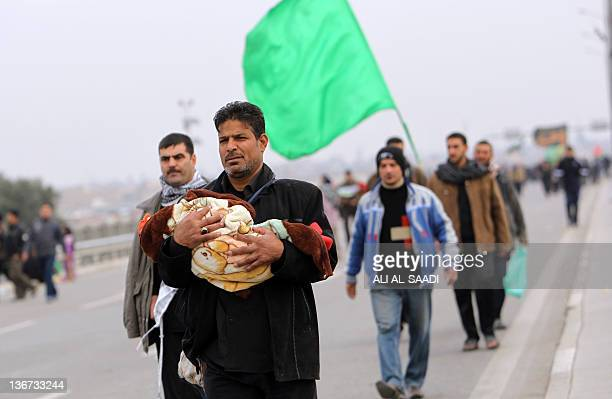 Iraqi Shiite Muslim pilgrims walk on January 11 along the main highway linking the Iraqi capital to the central shrine city of Karbala where they...