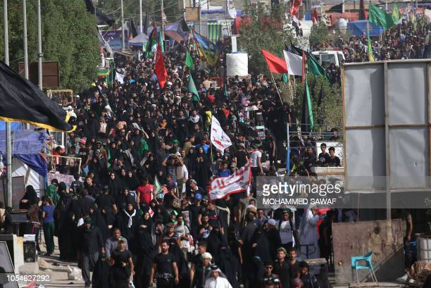 Iraqi Shiite Muslim pilgrims walk towards the central Iraqi shrine city of Karbala on October 28 ahead of the Arbaeen religious festival which marks...