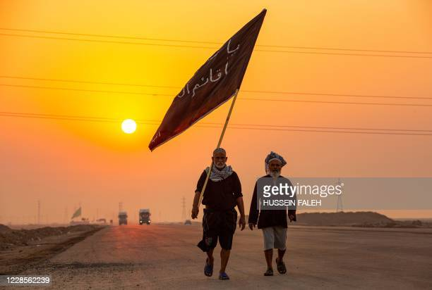 Iraqi Shiite Muslim pilgrims who began their march from the southern port city of al-Faw, walk through Basra on their way to the holy city of...