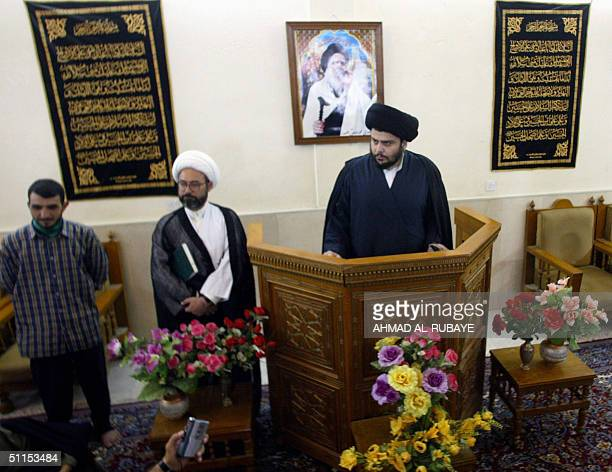 Iraqi Shiite Muslim radical cleric Moqtada Sadr gives a press conference at the shrine of Imam Ali in the holy city of Najaf 09 August 2004 under a...