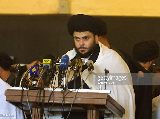 Iraqi Shiite Muslim radical leader Moqtada Sadr delivers his Friday sermon after the weekly prayers at he Kufa mosque on the outskirts of the holy...